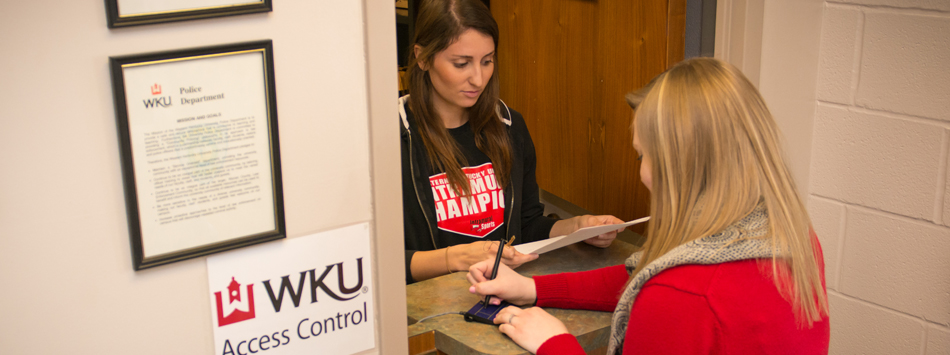 Student picking up keys at WKU Access Control service window