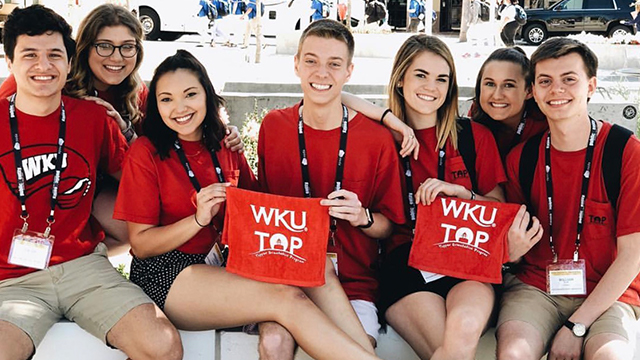 Students attending the Topper Orientation Program holding WKU red towels