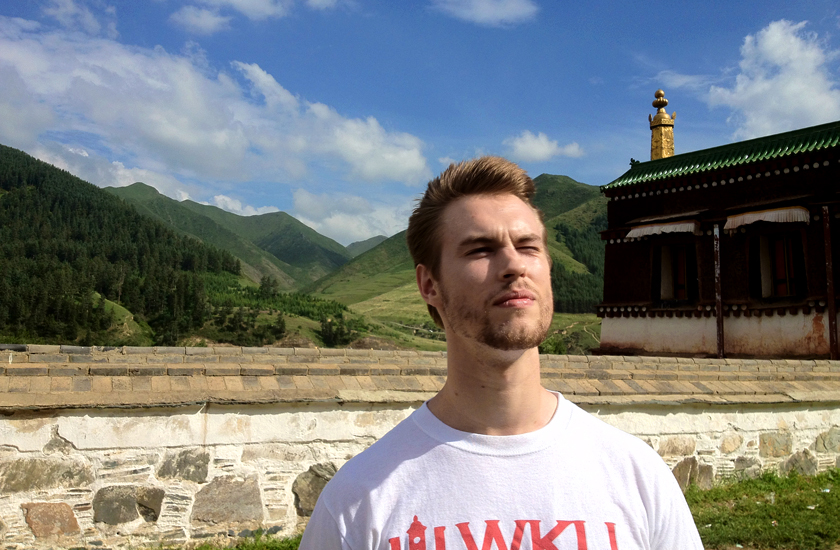 JP in Chine with mountains in the background.