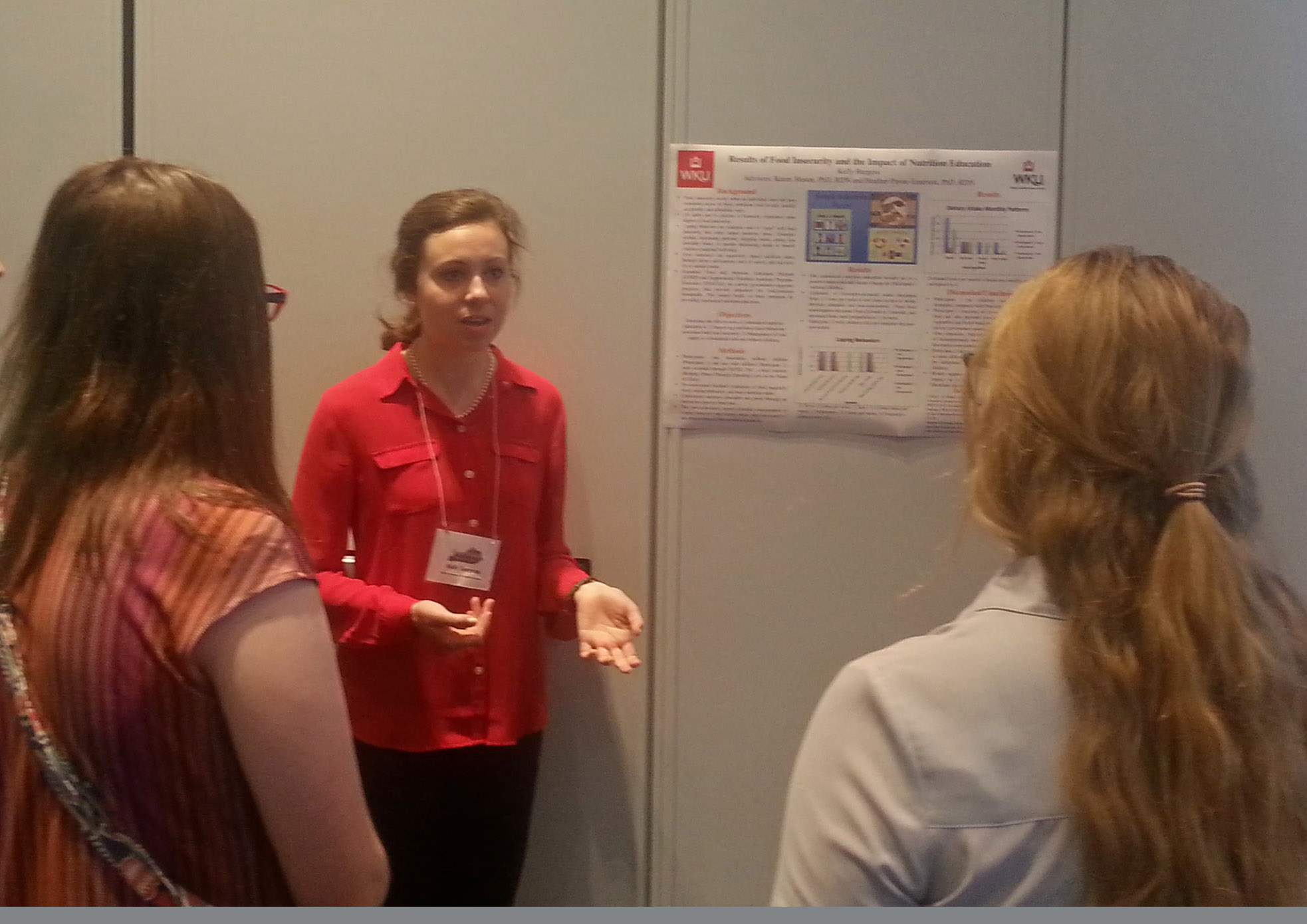 Kelly Burgess presenting poster