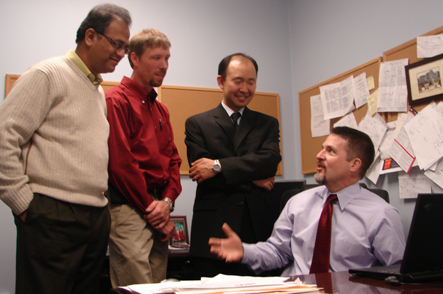 Photo of Management faculty meeting in the Center for Entrepreneurship.