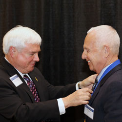 Executive Director of Beta Gamma Sigma, James Viehland presents the BGS Medallion for Entrepreneurship to Don Vitale