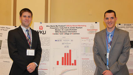 Jordan Nushart and Cody Kirk present their research during REACH Week.