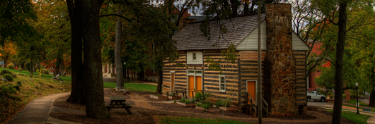 Photo of the Log House on WKU's main campus by Clinton Lewis.