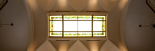 Photo of stained glass ceiling in Van Meter hall by Clinton Lewis.