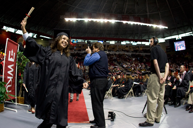 Photo of student graduating by Clinton Lewis.