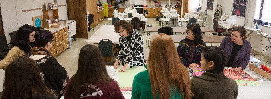 Gloria Carrico instructs students in her Basic Apparel Construction course.