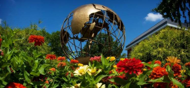 Globe Statue and Flowers