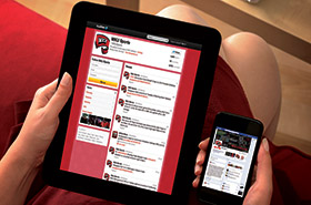 Person viewing WKU Sports Feeds on mobile devices