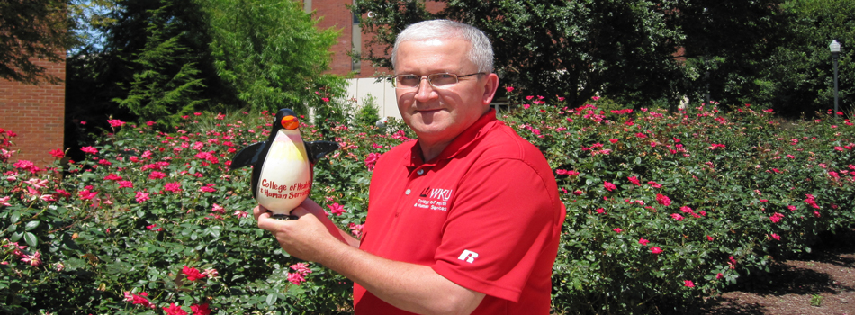 Dr. Etienne with Paco - The Gold Penguin Award