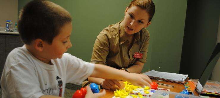 A Communication Disorders student during a therapy session with her client
