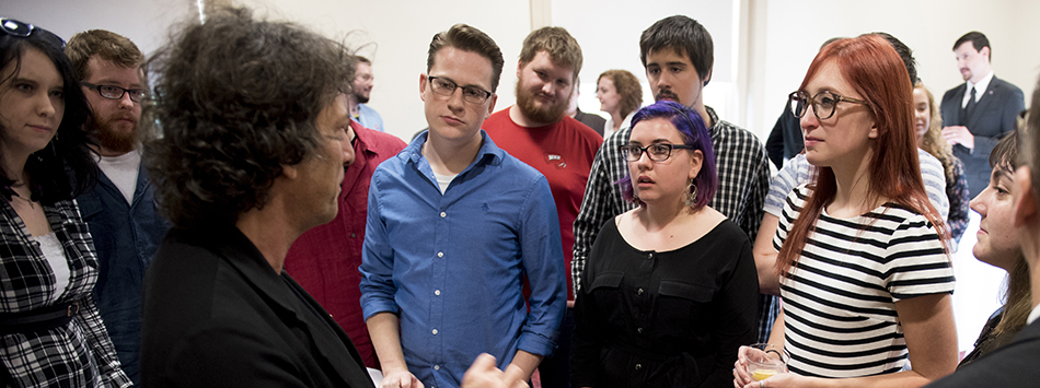 Author Neil Gaiman greets WKU students before his on stage interview, photo by William Kolb