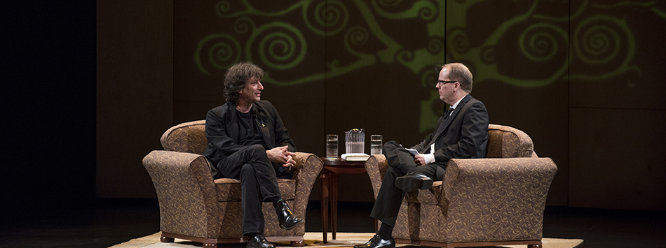 Author and WKU English Prof David Bell interviews author Neil Gaiman on stage at Van Meter, photo by William Kolb