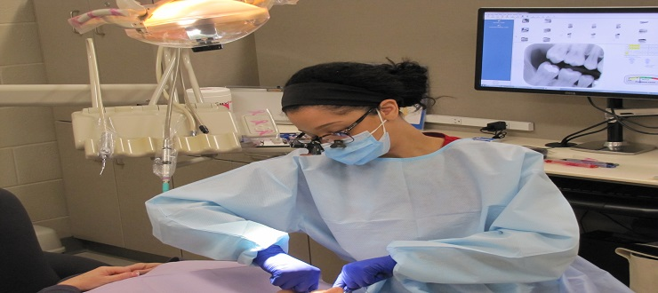 Dental Hygiene student practices with patient in clinic