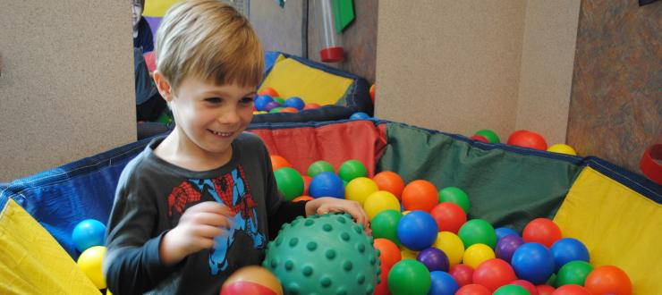 Child playing in the ball pit