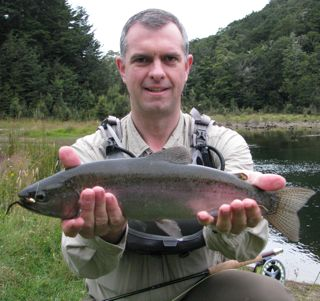Dr. Poff with trout in New Zealand