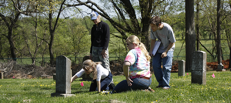 Anthropology students and faculty documenting grave markers at a local cemetery