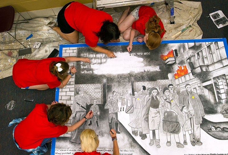 Students put the final touches on the 2015 VAMPY Holocaust mural on the last day of VAMPY, July 10, 2015. Alumni of the Nazi Germany and the Holocaust class will be invited back to campus Tuesday, July 11, 2017.