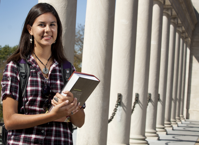 An Honors student stands by the Colonnade
