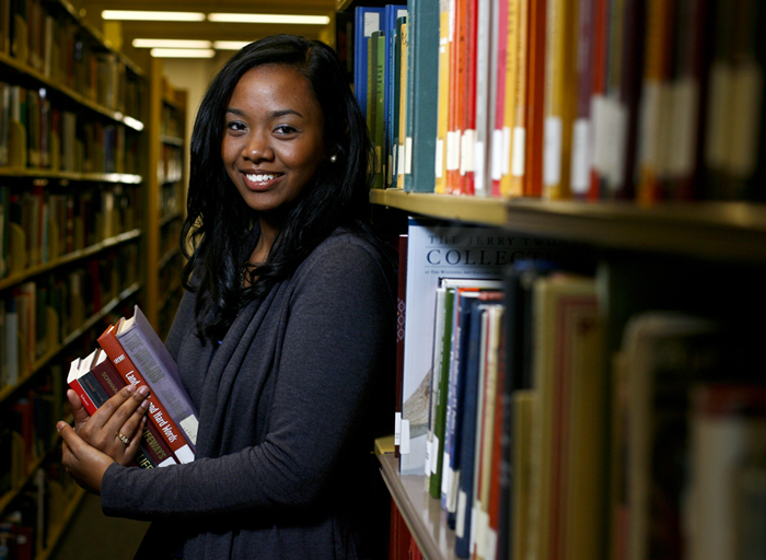 An Honors student stands in the library at WKU.
