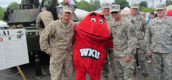 Big Red posed with Marine and Army personnel at the May 18th Hooray For Heroes celebration of Armed Forces Day in Radcliff, KY.