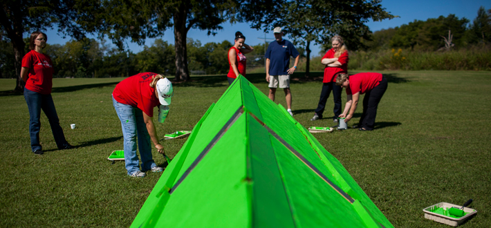 Staff members from the Department of Facilities Management combined efforts last week to construct obstacles for the Light of Chance Hullabaloo family obstacle course, presented by the Bowling Green Kiwanis Club on Sept. 20.