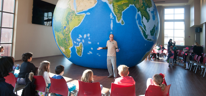 Students visited the GeoSphere during International Education Week at WKU.  The 20 foot inflatable globe provides an educational opportunity for students to learn about natural vegetation, mountains, water bodies, latitude and longitude, tectonic boundaries and city symbols.