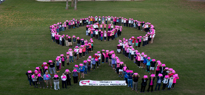 181 WKU faculty, staff, and students joined together to make a human breast cancer ribbon in support of Breast Cancer Awareness.