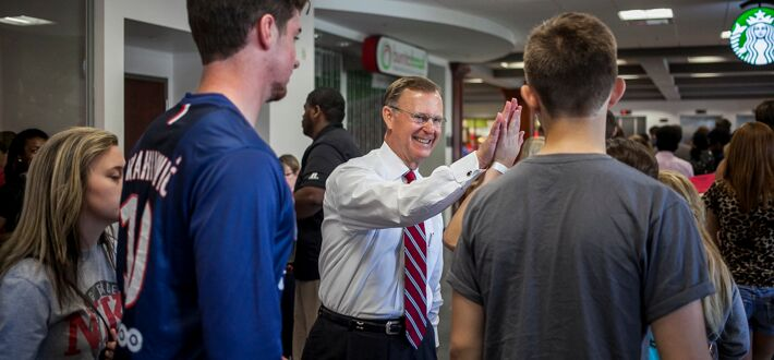WKU President Gary Ransdell high-fives incoming freshmen students at the July 14 Academic Transitions Program.