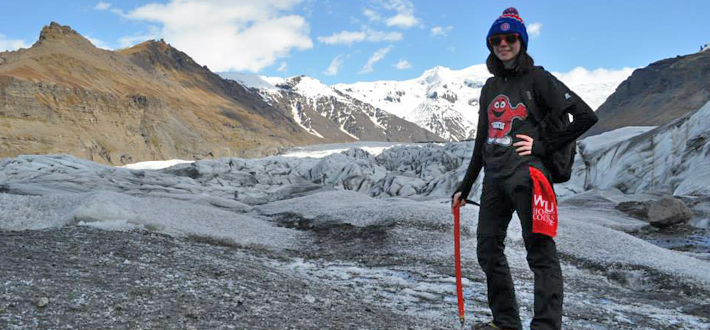 WKU student Tara Sorrels on top of Svinafellsjokull glacier tongue, which the Climate Change Challenge Study Abroad Group explored prior to the start of her summer internship and research endeavors in Iceland.