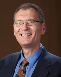 Dr. Dennis George