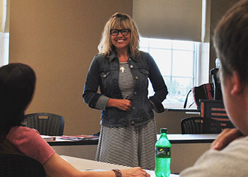 Faculty member guides students on path to higher learning
