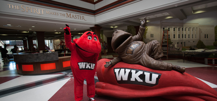 Big Red poses beside his new statue in DSU.