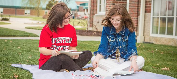 Students studying on WKU's campus