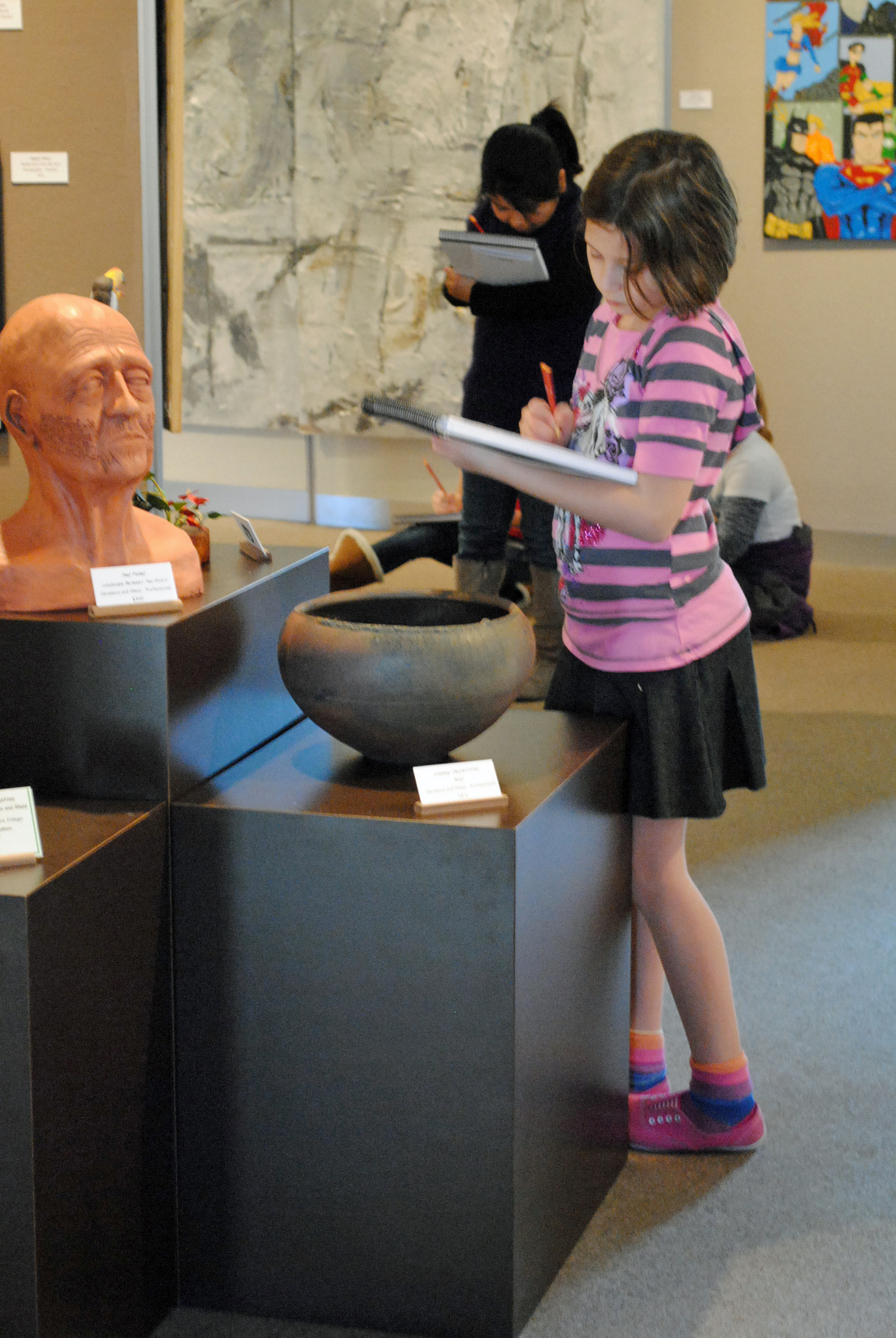 girl sketching in art gallery