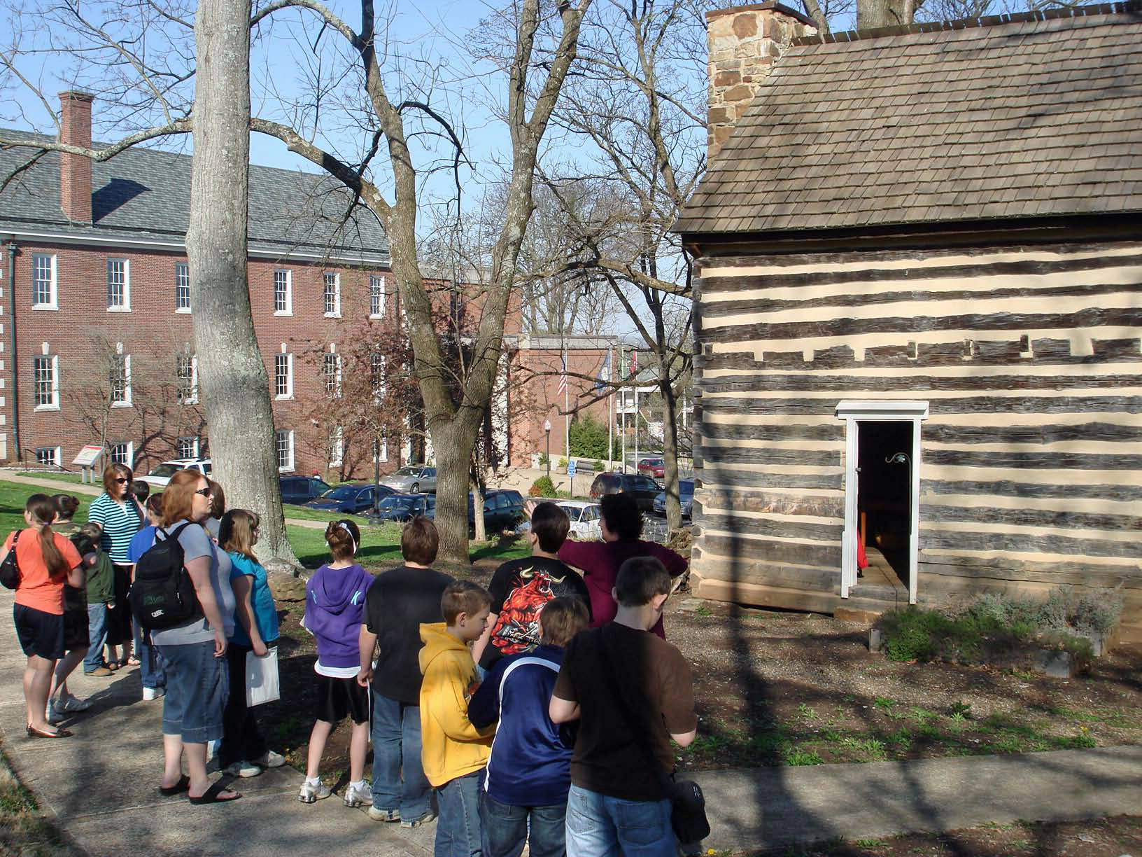 Outside of Felts Log house with fieldtrip