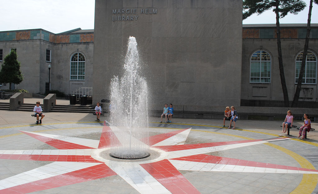 Fountain in front of Helm Library with children sitting around it