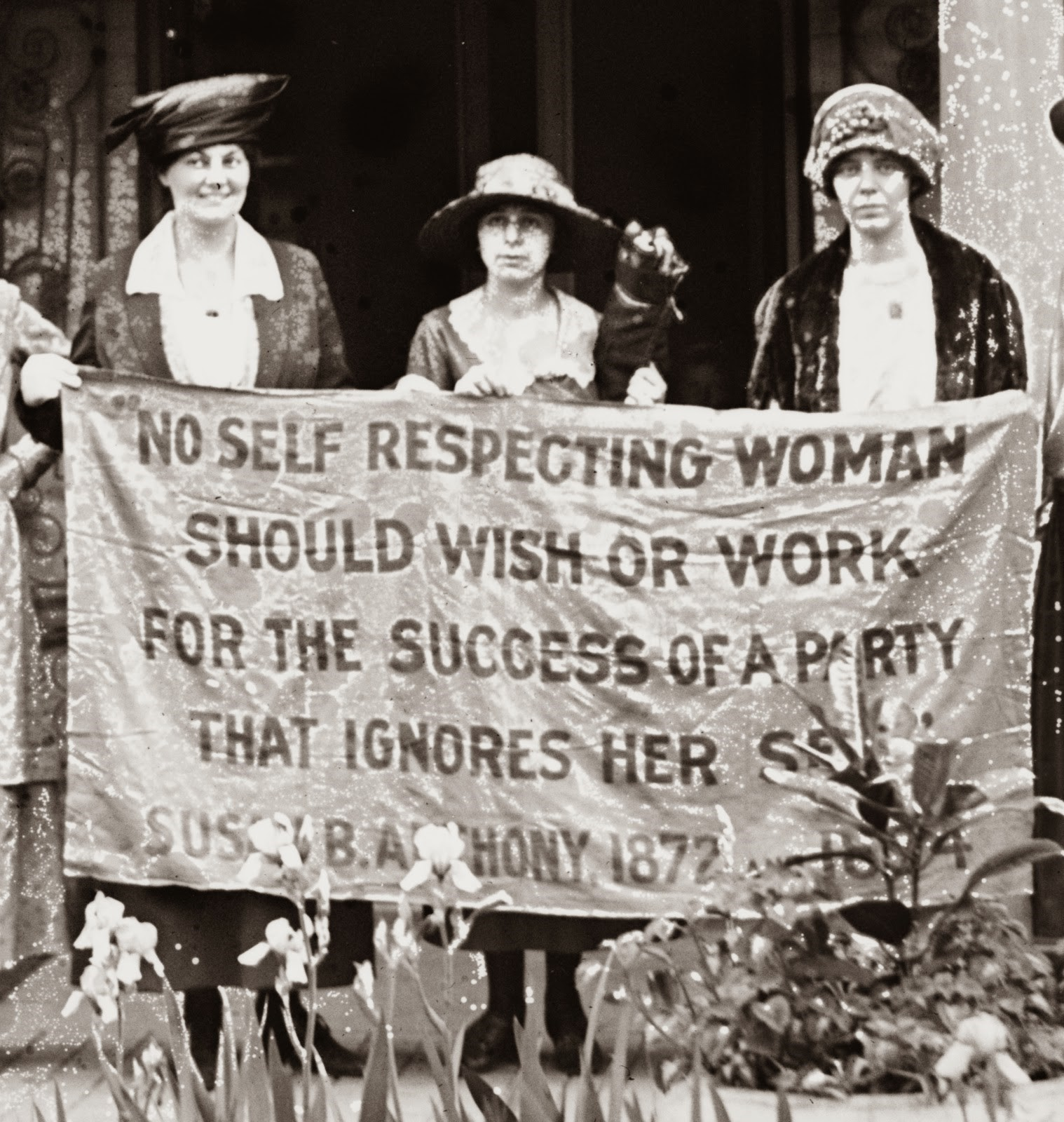 Suffragettes with banner