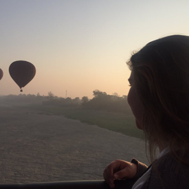 Molli looking at a Hot Air Balloon