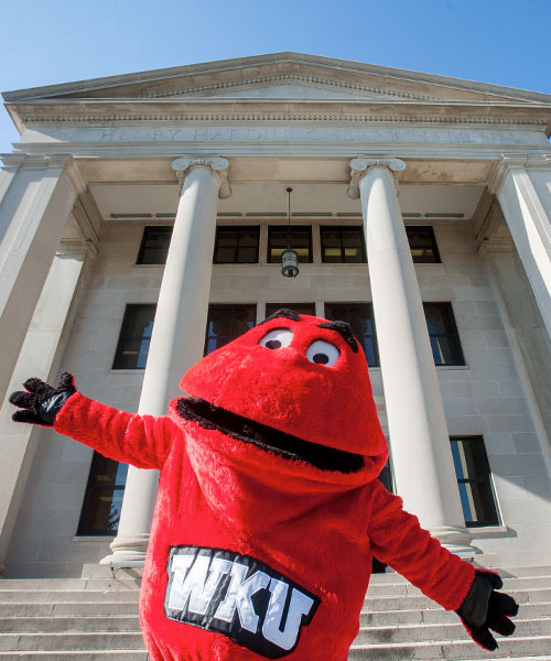 Big Red with arms open in front of Cherry Hall