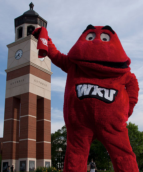 Big Red holding a towel in front of Guthrie Bell Tower