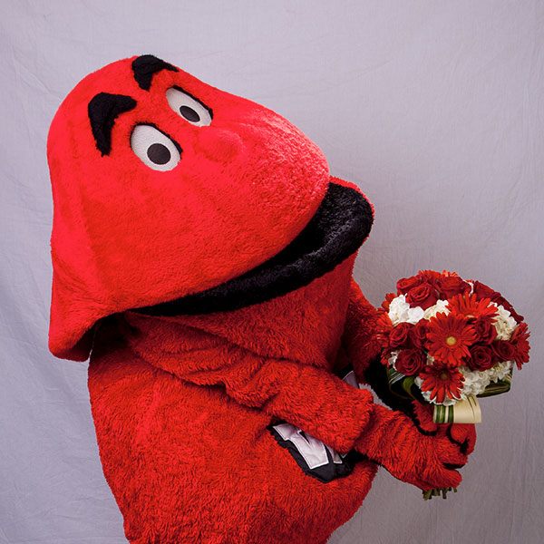 Big Red holding a bouquet of flowers
