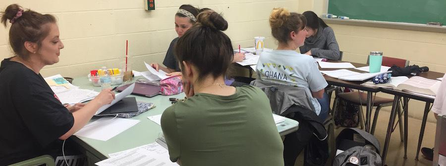 Ashley Merritt (left) assisting students with Biophysics II questions.