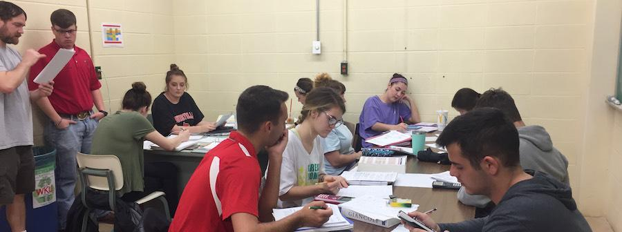 Students hard at work on Biophysics in the Physics Help Center.
