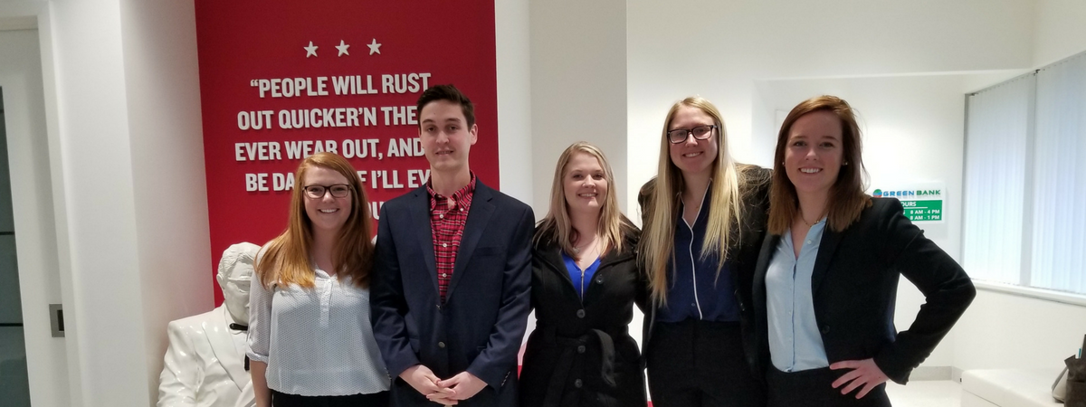Finance students visiting the YUM Corporation to prepare for the CFA Institute Research Challenge Competition.