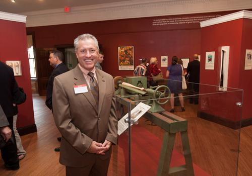 Rick Redman, Vice President of the Hillerich & Bradsby Co. brought custom Louisville Slugger bats to commemorate the opening of the exhibit.
