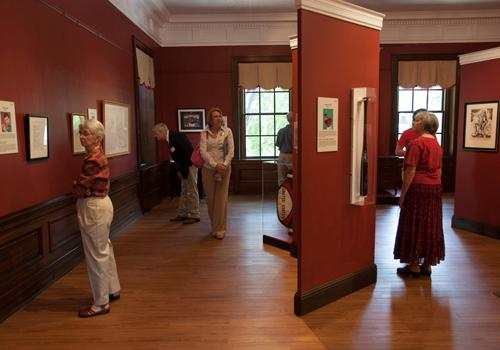 Guests at the opening enjoyed reading the stories about each of the items on display in the IAE exhibit.