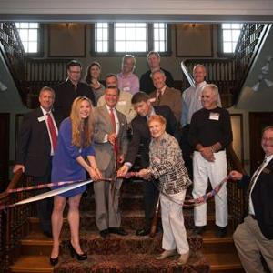 Contributors to the IAE exhibit assisted President Ransdell, Dan Murph and others in cutting the ribbon to officially open in the exhibit to the public.