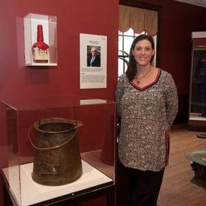 Sydina Bradshaw from Maker's Mark was one of several contributors in attendance. This bucket, in which the old family recipe was burned, represents the origin of Maker's Mark.