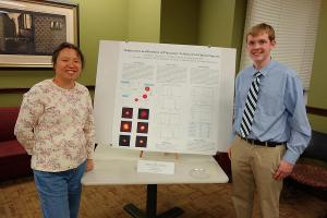 Gatton Academy student Benjamin Riley presenting his research results with Dr. Lee.
